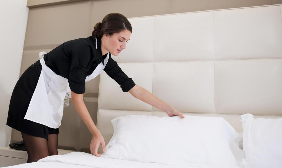 hotel-maid-making-white-bed